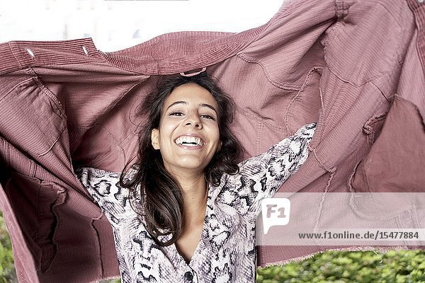 Cheerful woman with pink corduroy jacket