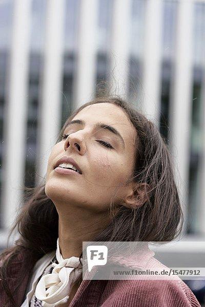 Sensitive woman in city