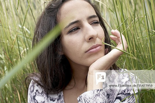 Thoughtful woman in nature