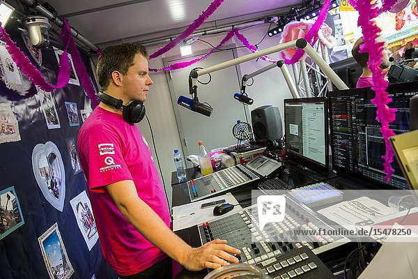 Tilburg  Netherlands. DJ Edwin Noorlander of Radio 538 during his Radio Show at the annual fair's Pink Monday.
