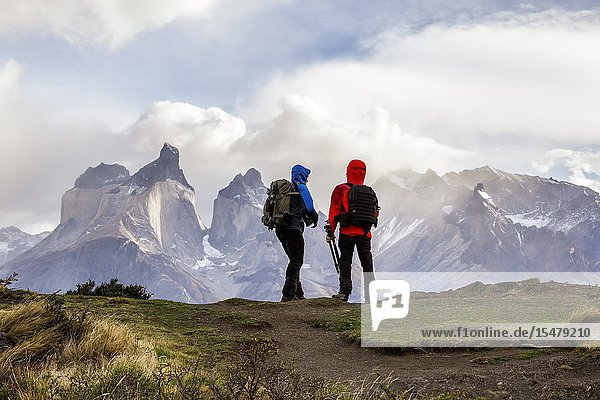 Chile Patagonia Magallanes and Chilean Antarctica Region Ultima Esperanza Province Torres del Paine National Park two person chat while watching Paine Horns.