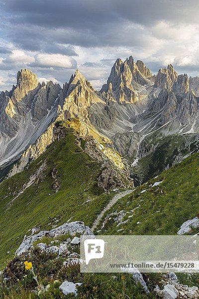 Italy Veneto Belluno district Auronzo di Cadore a man surrounded by the peaks of Cadini di Misurina.