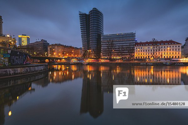 Vienna  Austria  Europe. The Uniqa Tower reflected in the Danube Canal.