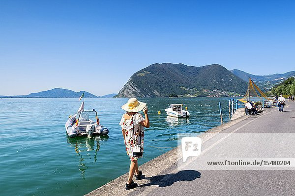 Tourist in the streets of Peschiera Maraglio  Monteisola  Brescia province  lombardy district  Italy.