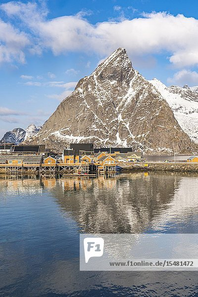 Olstinden peak reflecting on the sea at Sariskoy. Reine  Lofoten district  Nordland county  Northern Norway  Norway.