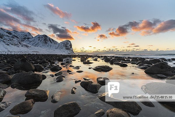 Sunset at Unstad Beach in winter. Vestvagoy municipality  Nordland county  Northern Norway  Norway.