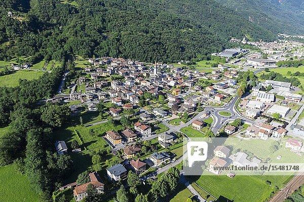 Hang gliding over the village of Rogolo  lower Valtellina  Sondrio province  Lombardy  Italy.