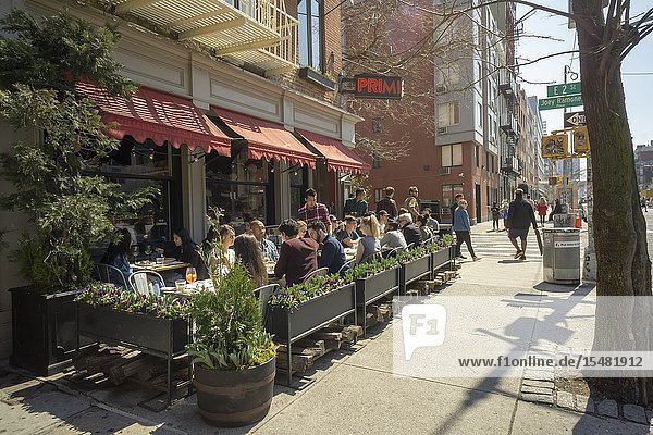 Al fresco dining is de rigueur in the East Village in New York during a warm spring day on Saturday  April 6  2019 (© Richard B. Levine).