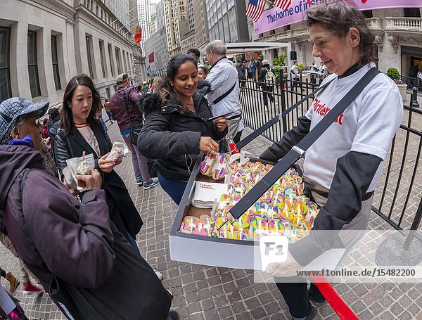 Rainbow bagels and other treats are distributed outside the New York Stock Exchange in celebration of the first day of trading for Pinterest's initial public offering (IPO) in Lower Manhattan in New York on Thursday  April 18  2019. The social media giant priced its shares at $19 making the company worth over $10 billion  well into the 'unicorn' range. (© Richard B. Levine).