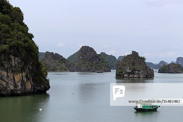 Fishing boat  Halong Bay listed as World Heritage by UNESCO  Quang Ninh Province  Vietnam  Asia.