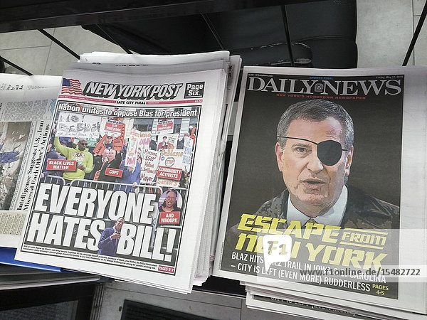 Front pages of the New York Daily News and New York Post newspapers comment on New York Mayor Bill De Blasioâ.s announcement that he is joining the 21 other contenders to run for U. S. president in 2020. (© Richard B. Levine).