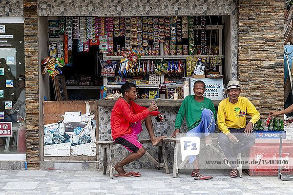 Three Filipinos Sitting Outside A Shop  Boracay  Aklan Province  The Philippines.