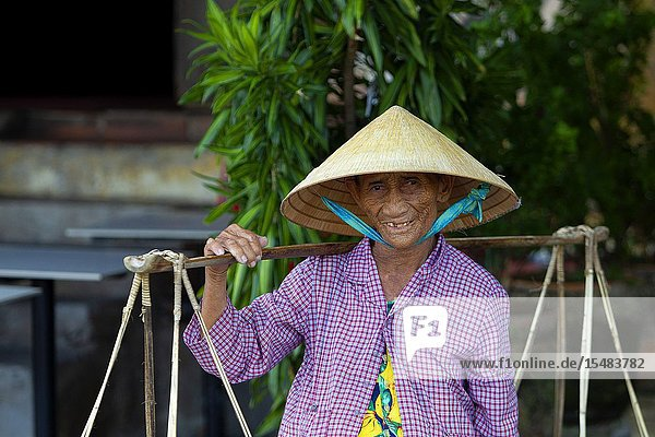 Vender in Hoi An Ancient Town  Quang Nam Province  Vietnam.