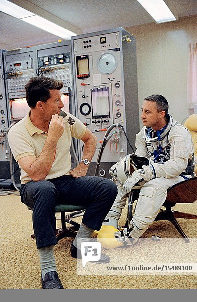 Astronaut Virgil I. Grissom (right)  the command pilot of the Gemini-Titan 3 three-orbit mission  is shown with astronaut Walter M. Schirra Jr. in the ready room at Pad 16. The GT-3 was launched from Pad 19 the same day. Schirra was the command pilot of the backup crew.