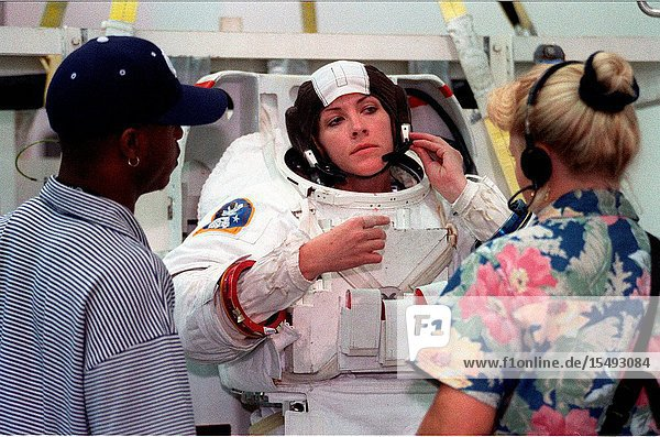 Astronaut Janet L. Kavandi  mission specialist  checks her communications head gear as she stands on a movable platform. Minutes later she was lowered into a nearby deep pool for an underwater training session at the Johnson Space Center's Neutral Buoyancy Laboratory (NBL)  part of the Sonny Carter Training Center. Kavandi has weights on the training version of her extravehicular mobility unit (EMU) which help to provide neutral buoyancy in the pool. Astronauts Kavandi and Gerhard P.J. Thiele were participating in a rehearsal of a contingency space walk.