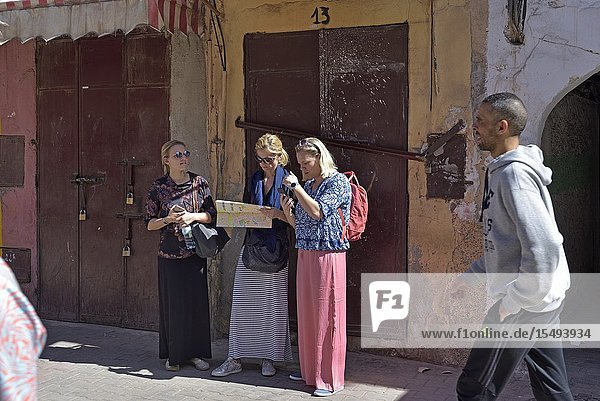 Tourists looking for their way in the Medina of Marrakech  Morocco  North West Africa.