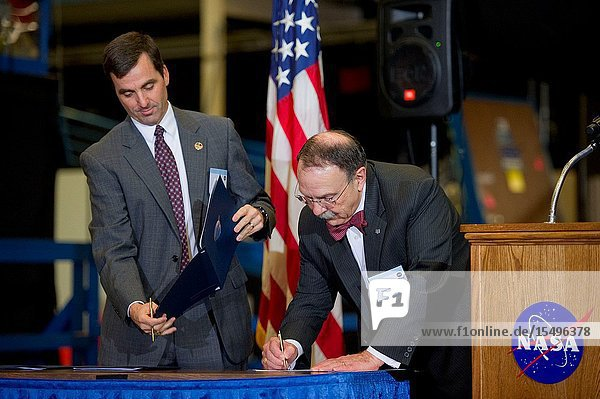Texas AM University President Dr. R. Bowen Loftin (right) and Paul Hill  director of mission operations  sign the Space Act Agreement between NASA's Johnson Space Center and Texas AM University on Dec. 19  2011 to begin the move of the primary space shuttle launch and landing trainer  the Shuttle Motion Simulator  to College Station. The NASA-Texas AM partnership will allow the university to house and showcase unique historical space shuttle training artifacts and the space shuttle training technology it represents will be preserved and used to inspire future engineers. The SMS provided a full-motion simulation of shuttle launches and landings for every crew that flew on the shuttle. It began operations at JSC in 1977 and was used in training for all 135 space shuttle missions.