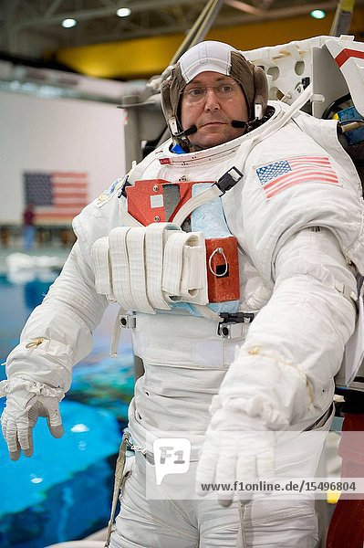 Astronaut Mike Foreman  STS-129 mission specialist  attired in a training version of his Extravehicular Mobility Unit (EMU) spacesuit  awaits the start of a spacewalk training session in the waters of the Neutral Buoyancy Laboratory (NBL) near NASA's Johnson Space Center.