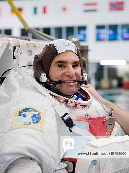 NASA astronaut Greg Chamitoff  STS-134 mission specialist  attired in a training version of his Extravehicular Mobility Unit (EMU) spacesuit  awaits the start of a spacewalk training session in the waters of the Neutral Buoyancy Laboratory (NBL) near NASA's Johnson Space Center.