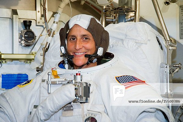 NASA astronaut Sunita Williams  Expedition 32 flight engineer and Expedition 33 commander  participates in an Extravehicular Mobility Unit (EMU) spacesuit fit check in the Space Station Airlock Test Article (SSATA) in the Crew Systems Laboratory at NASA's Johnson Space Center.