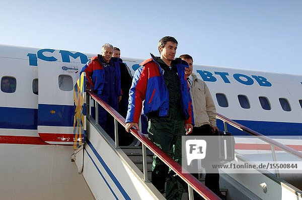 Members of the 11th expedition to the international space station  astronaut John L. Phillips (left) and cosmonaut Sergei K. Krikalev (right) arrive at Star City  Russia. The crew had earlier landed near Arkalyk  Kazakhstan Oct. 11 local time after a six-month mission in orbit. Along with space flight participant Greg Olsen (not pictured)  who visited the station for more than a week  Phillips and Krikalev returned to Earth aboard a Russian Soyuz spacecraft.
