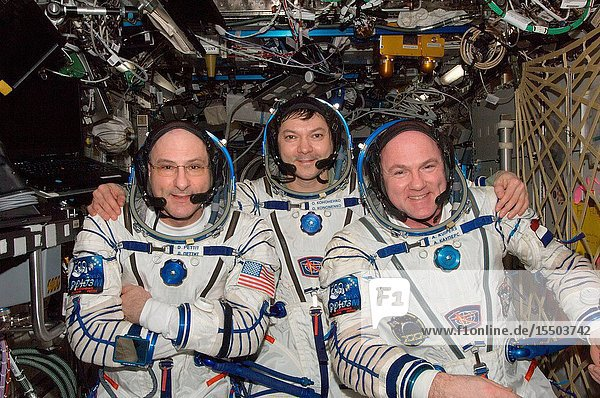 Russian cosmonaut Oleg Kononenko (center)  Expedition 31 commander  along with NASA astronaut Don Pettit (left) and European Space Agency astronaut Andre Kuipers  both flight engineers  attired in Russian Sokol launch and entry suits  pose for a photo in the Destiny laboratory of the International Space Station.