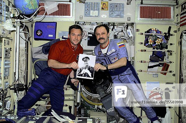 Celebrating the recent 40th anniversary of the first human-tended space flight  Rosaviakosmos cosmonauts Yuri V. Lonchakov and Yury V. Usachev hold a photo of the late cosmonaut Yuri Gagarin. The STS-100 mission specialist and the Expedition Two commander are in the Zvezda Service Module on the International Space Station (ISS). Usachev and two Americans are currently hosting Lonchakov and six astronauts as work continues on the orbiting outpost. The photo was taken with a digital still camera.