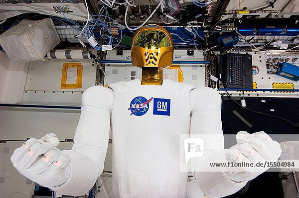 Robonaut 2 -- the first dexterous humanoid robot in space -- is pictured in the Destiny laboratory of the International Space Station. NASA astronaut Mike Fossum  Expedition 29 commander  and Japan Aerospace Exploration Agency astronaut Satoshi Furukawa (both out of frame)  flight engineer  spent several hours in Destiny checking out and operating R2.