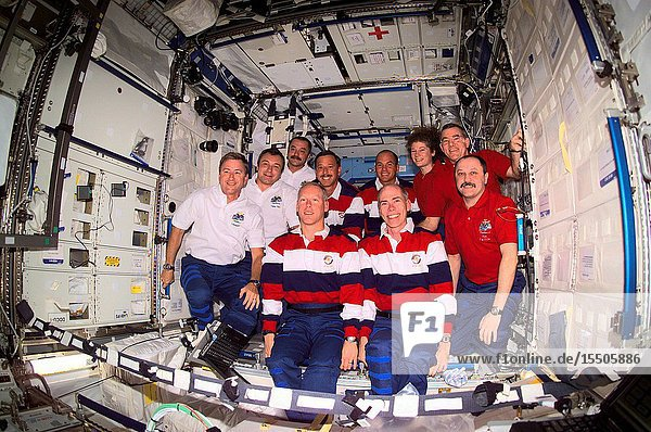 The Expedition Three (white shirts)  STS-105 (striped shirts)  and Expedition Two (red shirts) crews assemble for a group photo in the Destiny laboratory on the International Space Station (ISS). The Expedition Three crew members are  from front to back  Frank L. Culbertson  Jr.  mission commander  and cosmonauts Vladimir N. Dezhurov and Mikhail Tyurin  flight engineers  STS-105 crew members are  front row  Patrick G. Forrester and Daniel T. Barry  mission specialists  and back row  Scott J. Horowitz  commander  and Frederick W. (Rick) Sturckow  pilot  Expedition Two crew members are  from front to back  cosmonaut Yury V. Usachev  mission commander  James S. Voss and Susan J. Helms  flight engineers. Dezhurov  Tyurin and Usachev represent Rosaviakosmos. This image was taken with a digital still camera.