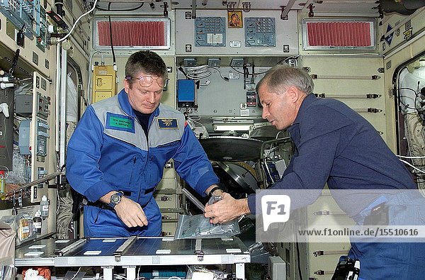 The shuttle and station commanders are pictured at the kitchen table onboard the International Space Station in this digital still camera's view  recorded not long after the two crews reunited aboard the outpost. Astronaut William M. (Bill) Shepherd (left) is Expedition One commander and astronaut Kenneth D. Cockrell serves as mission commander for the five-member STS-98 crew.