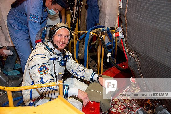 At the Baikonur Cosmodrome in Kazakhstan  Expedition 4041 Flight Engineer Alexander Gerst of the European Space Agency poses for a picture May 16 in his Russian Sokol launch and entry suit as he enters the Soyuz TMA-13M spacecraft during a dress rehearsal fit check. Gerst  NASA Flight Engineer Reid Wiseman and Soyuz Commander Maxim Suraev of the Russian Federal Space Agency (Roscosmos) are scheduled to launch from Baikonur on May 29  Kazakh time  for a 5 ½  month mission on the International Space Station. Victor Zelentsov