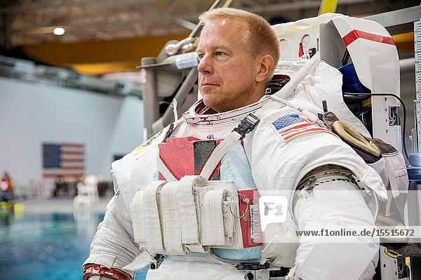 NASA astronaut Tim Kopra  Expedition 46 flight engineer and Expedition 47 commander  attired in a training version of his Extravehicular Mobility Unit (EMU) spacesuit  awaits the start of a spacewalk training session in the waters of the Neutral Buoyancy Laboratory (NBL) near NASA's Johnson Space Center.Robert Markowitz
