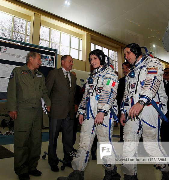 At the Gagarin Cosmonaut Training Center in Star City  Russia  Expedition 4243 Flight Engineer Samantha Cristoforetti of the European Space Agency (suited left) and Soyuz Commander Anton Shkaplerov of the Russian Federal Space Agency (Roscosmos) walk to a Soyuz simulator October 31 during the second day of qualification exams. Cristoforetti  Shkaplerov and NASA Flight Engineer Terry Virts are preparing for launch in the Soyuz TMA-15M spacecraft from the Baikonur Cosmodrome in Kazakhstan Nov. 24  Kazakh time  for a 5 ½  month mission on the International Space Station..NASAStephanie Stoll.