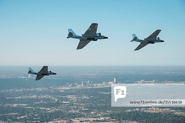 The historic WB-57 formation flight of three WB-57's over the Houston area as it passes by the Houston Galleria on Nov. 19  2015. NASA Photographer: Robert Markowitz