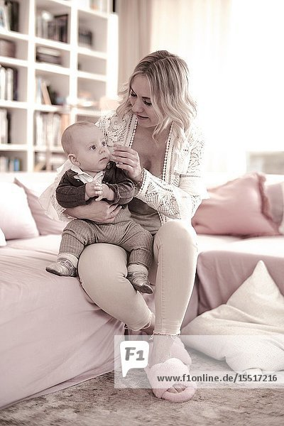 Woman with baby on lap