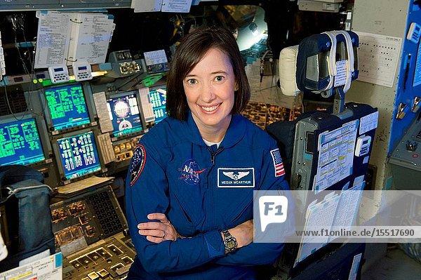 Portrait of Astronaut Megan McArthur (in blue flight suit) taken in Bldg. 5 Motion Based Simulator.