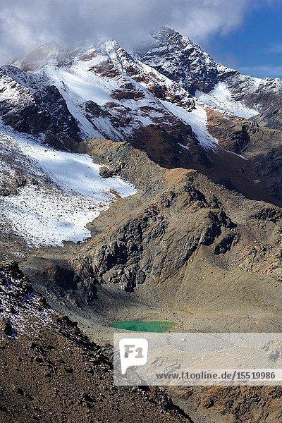 Small glacier lake near Passo di Zebrù  near Rifugio Pizzini hut  Val Cedec  Valfurva  Valtellina  Province of Sondrio  Lombardy  Italy.
