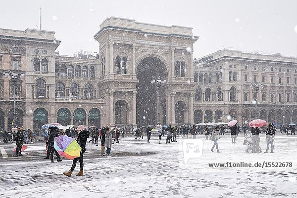 The gallery of Vittorio Emanuele II and Piazza Duomo in winter during snowfall  Milan  Lombardy  Italy  Europe.