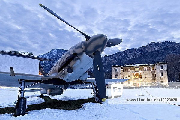 The Aermacchi 205 airplane and the Albere Palace in Trento. Trentino Alto-Adige  Italy  Europe.