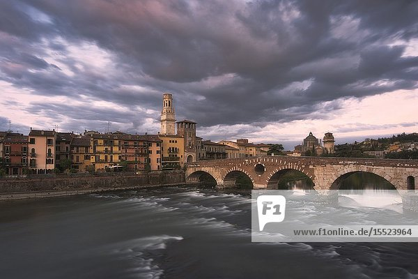Stone bridge Verona along the Adige river Veneto Italy Europe.