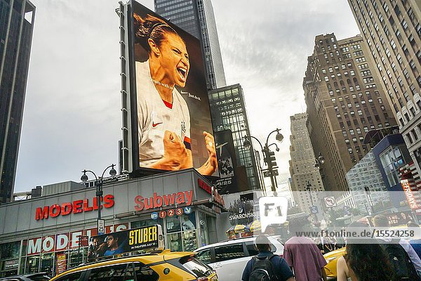 An electronic billboard for Nike products on Wednesday  July 3  2019 features members of the USA Women's Soccer Team  currently playing in the World Cup. (© Richard B. Levine).