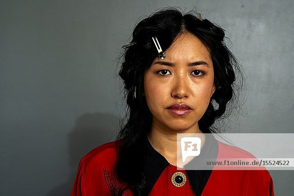 Tilburg  Netherlands. Studio portrait of a beautiful  Korean female student looking angry.