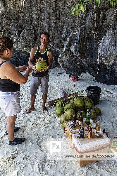 A Local Man Selling Cold Drinks and Buko Juice At Entalula Beach  El Nido  Palawan  The Philippines.
