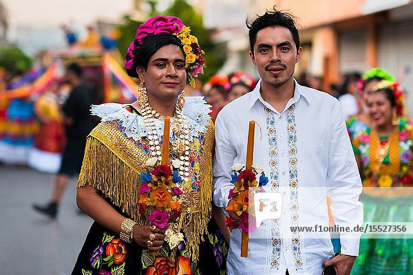 A Mexican â. œmuxeâ.(typically  a homosexual man wearing female clothes)  posing with her boyfriend  takes part in the traditional procession during the Vela de las Intrépidas festival in Juchitán de Zaragoza  Oaxaca  Mexico  17 November 2018. In the Istmo de Tehuantepec region of southern Mexico  the Zapotec indigenous society traditionally divides people into three genders: male  female and muxes. The â. œthird genderâ.(muxes) generally represents those who identify as a different gender than assigned at birth. Muxes are shown respect  they contribute to society as artists  merchants  or they stay at the parentsâ.home doing womenâ.s work. Although the three gender system originates in pre-Hispanic indigenous culture  the phenomenon of muxes dressing publicly as women started in the 1950s and has been gaining popularity until today.