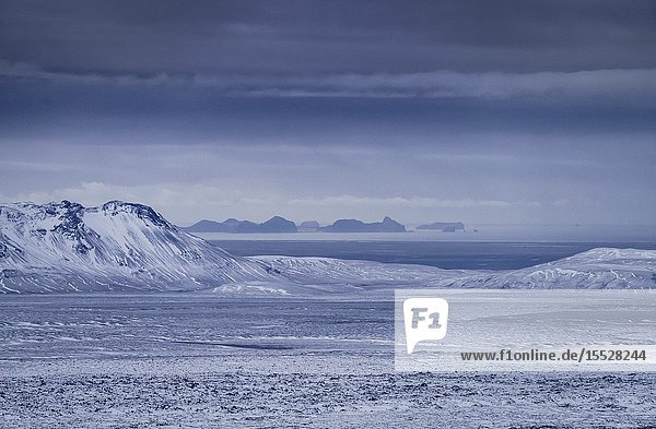Keldnahraun lava covered with snow  Westman Islands in the background  Iceland.