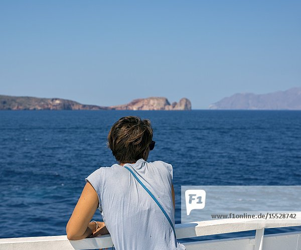 Woman looking at the sea from the ferry  Milos island  Cyclades  Greece