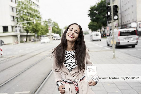 Happy confident woman at street