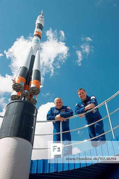 At the Cosmonaut Hotel crew quarters in Baikonur  Kazakhstan  Expedition 51 crewmembers Fyodor Yurchikhin of the Russian Federal Space Agency (Roscosmos  left) and Jack Fischer of NASA (right) pose for pictures next to a Soyuz rocket model April 13 as part of pre-launch activities. Fischer and Yurchikhin will liftoff April 20 from the Baikonur Cosmodrome on the Soyuz MS-04 spacecraft for a four and a half month mission on the International Space Station. NASAVictor Zelentsov