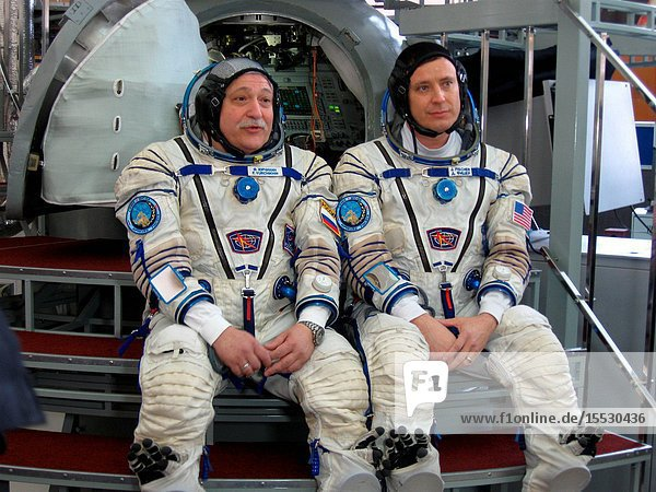 At the Gagarin Cosmonaut Training Center in Star City  Russia  Expedition 51 crewmembers Fyodor Yurchikhin of the Russian Federal Space Agency (Roscosmos  left) and Jack Fischer of NASA (right) field questions from reporters in front of a Soyuz spacecraft mockup March 31 during the second of two days of final qualification exams. Yurchikhin and Fischer will launch April 20 on the Soyuz MS-04 spacecraft from the Baikonur Cosmodrome in Kazakhstan for a four and a half month mission on the International Space Station. Expedition 51. Photo: Rob NaviasNASA.