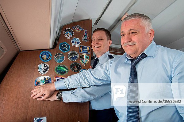Aboard a Gagarin Cosmonaut Training Center aircraft  Expedition 51 crewmembers Jack Fischer of NASA (left) and Fyodor Yurchikhin of the Russian Federal Space Agency (Roscosmos  right) display their Expedition crew patch on the wall of the cabin April 5 as they traveled to their launch site at the Baikonur Cosmodrome in Kazakhstan for final pre-launch training. Fischer and Yurchikhin will launch April 20 on the Soyuz MS-04 spacecraft for a four and a half month mission on the International Space Station. Photo: NASAVictor Zelentsov